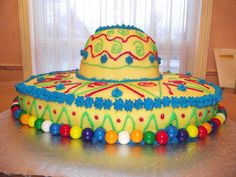 Make 2 sheet cakes for the base-cut each into semi circles and join with icing. Make the top of the hat with one cake mix in a large glass bowl (Pampered Chef makes a great one). *no link Fiesta Cake, Fiesta Theme Party, Taco Party, Mexican Birthday, Mexican Party, 2nd Birthday, Birthday Ideas, Cumpleaños Diy, Sunshine Birthday Parties