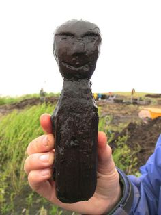Archaeologists digging at a 700-year-old coastal village in Alaska that has been exposed by erosion and melting ice have uncovered 60 wooden dolls that were used as toys and for ceremonial purposes.