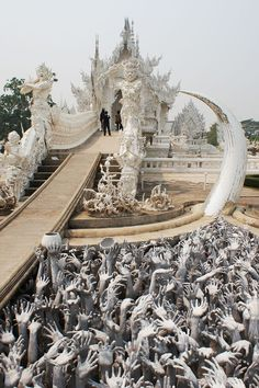 Wat Rong Khun, better known as the White Temple, is a Buddhist temple in Thailand that looks like it was placed on earth by a god.