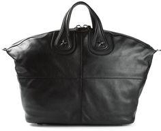 €2,455, Bolsa de Viaje de Cuero Negra de Givenchy. De farfetch.com. Detalles: https://lookastic.com/men/shop_items/142901/redirect