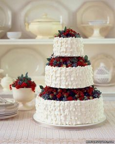 BASKET OF BERRIES WEDDING CAKE Early summer is the best time to choose a cake like this one -- brimming with a fresh and varied assortment of the season's best berries. Red currants, raspberries, gooseberries, blueberries, and strawberries look beautiful jumbled together on basket-weave tiers.