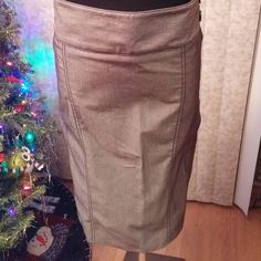 New Listing! Adorable pencil skirt Brand new with tags! Gray pencil skirt with black stitching & button accents at the waist.  Side zipper. Faux back pockets.  Lying flat, measurements are: waist 20 inches, length 21 inches.   FREE GIFT WITH PURCHASE Smoke free home Always open to offers! Please use the offer button. Willing to negotiate the price! Maurices Skirts Pencil