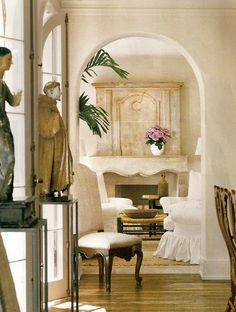 Love the overall look with french doors, statues (sculpture), stone, plaster, arched door...  Pam Pierce