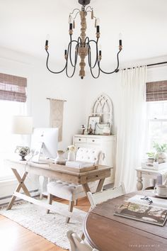 A lovely casual home office with lots of light, soft textures, and gorgeous greenery.