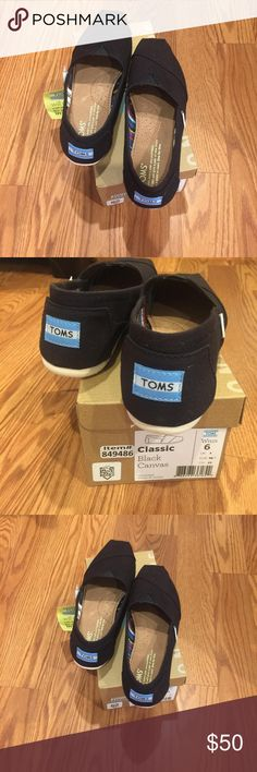 NWT Toms black canvas shoes All new. Comes with stickers. No burlap bag Toms Shoes Flats & Loafers