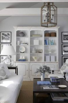 White living room. Design by Maureen Griffin Ballsbaugh. Styled by StacyStyle, photographed by Michael Partenio for New England Home.