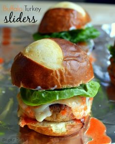 Buffalo Turkey Sliders - itsy bitsy turkey burgers loaded with buffalo sauce, some melty cheese and a pretzel bun. ALL THE YES.