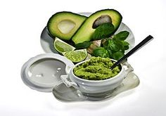 Awesome Guacamole Dip with presentation of Raw Avocado in great serving dishes. Good for Paleo Diet!    It sure is!! Love Avocado. Grows here in NZ.