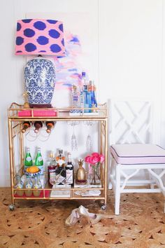 We love the pretty-in-pink accessories on Mimosa and Monroe's styled brass bar cart. A trio of pink books, flowers, and a girly statement lamp keep it all in the color family! Diy Bar Cart, Bar Cart Styling, Bar Cart Decor, Bar Carts, Styling Tips, Brass Bar Cart, Gold Bar Cart, Social Bar, Bar Accessories