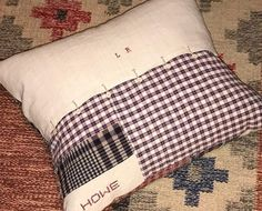 A hand stitched Kelsch patchwork cushion #madebyhowe with vintage linen and pure down filler finished with delicate linen covered buttons and a hand embroidered HOWE logo.