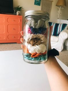 Stacked hair ties in jar 🧡💛💚💙 - Dorm Room Hacks Ideas