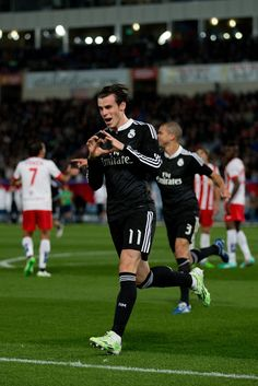 Gareth Bale of Real Madrid CF celebrates scoring their second goal during the La Liga match between UD Almeria and Real Madrid CF at Juegos del Mediterraneo stadium on December 12, 2014 in Almeria, Spain.