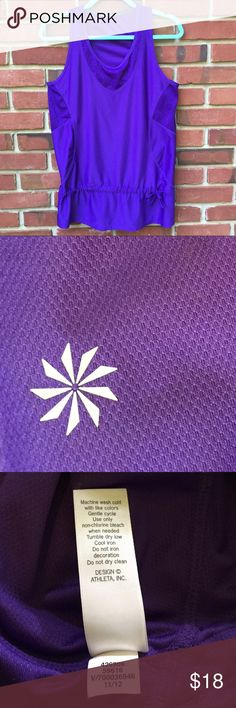 """Athleta """"wick-it good"""" top This purple Athleta """"wick-it good"""" top has a scoop neck and sheer mesh sides for wicking moisture. The drawstring tie can adjust for length and fitted waist. Note the signature insignia--scratchy tags were cut off for comfort. Chest: 18"""", length: 28"""", 91% polyester, 9% spandex. Great for all workouts. Worn once, excellent condition. Athleta Tops Tank Tops"""