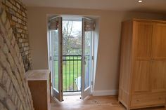 A full width L shaped rear dormer conversion into one bedroom and two bathrooms. Ash Island Lofts
