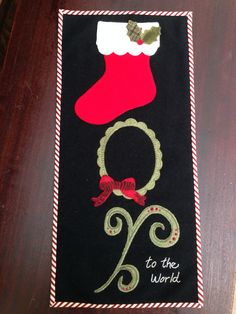 "Hand appliqué wool wall hanging by Mary Ann Thom. Adapted from ""Joy"" table mat from Pretty Penny Precuts."