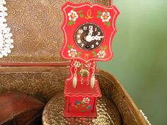 Wind up clock, German, Hand painted, wooden, wall clock by Traincasesandmore on Etsy