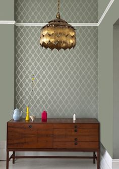 Feature wall in Crivelli Trellis wallpaper design by Farrow & Ball. Walls in Pigeon.