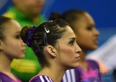 Brazil's Daniele Matias Hypolito waits for a score during the women's qualification at the Gymnastics World Championships in Nanning, in China's southern Guangxi province on October 5, 2014. AFP PHOTO/Greg BAKER ▼13Oct2014AFP|【写真特集】カメラがとらえた世界体操のワンシーン http://www.afpbb.com/articles/-/3028472