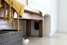 Litter box in a wardrobe. Secret entrance concealed under a bench!!  House Tweaking Concealed Litter Box | Remodelista