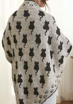 Free Knitting Pattern for Cat Shawl - Stranded colorwork shawl by Susanne Ljung features cat silhouettes with pawprint border. The English version of the pattern is at the bottom of the page, under the Swedish version.