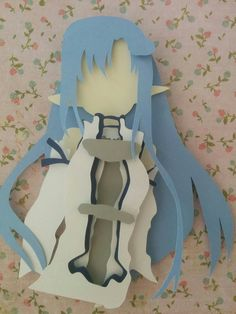 "Asuna with Sword Layered Paper Art Piece 8""x10"" Shadowbox Frame These Paper CutOuts are designed using Scale Vector Graphics and cut using a paper cutter for precision details. Than by hand they are arranged"
