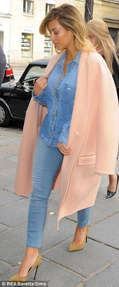 Double denim: Kim Kardashian wore a low-cut denim shirt and jeans as she headed out for lunch in the French capital on Tuesday