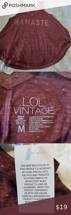 Tank top Never worn tank top with namaste on front. Color, is burgundy see tag in picture. L.O.L. Vintage Tops Tank Tops