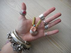 Kuripe with sea snail, leather, turquoises and copper spirals. www.facebook.com /MotherofWater