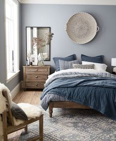 Solid wood and grey. Also, great big plate nordic-blue-and-grey-bedroom-with-wooden-bed-and-furniture-and-blue-and-white-bed-covers-cozy-nordic-look Light Gray Bedroom, Gray Bedroom Walls, Bedroom Red, Wood Bedroom, Small Room Bedroom, Home Decor Bedroom, Bedroom Furniture, Bedroom Ideas, Small Rooms