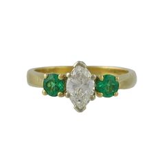 18K Yellow Gold Marquis Diamond and Emerald Ring, c. 1980. $1650