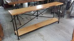 Gorgeous custom steel tables with live edge cypress.