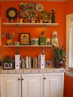 orange kitchen reminds me of my mama's (grandmother) kitchen. LOVE. those retro cannisters on white shelves look good over an old bench. bugger new. I love old stuff. cool cacti too. green, white, orange, red, yellow. love it.