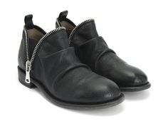 #21StepsStyleCourse   Cool booties: Evers by Fluevog  Do the zipper edges chafe? $299. Gah.