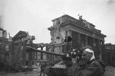 A wounded soldier films what remains of Berlin. Berlin 1945