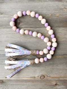 Garland Ideas, Diy Garland, Wood Bead Garland, Beaded Garland, Easter Decor, Easter Ideas, Fall Craft Fairs, Decorative Beads, Purple Hands