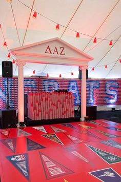 <p> A DJ booth was made of hundreds of stacked Solo cups and framed with columns that evoked a classic...