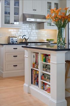 Small shelves built into kitchen island for books and accessories - Decoist