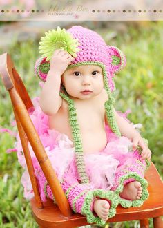 Newborn Adorable Pink Monkey Hat with Green Flower and Corkscrew Earflaps and Matching Legwarmers. $40.00, via Etsy.