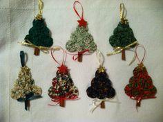 "Yo-yo cinnamon stick Christmas ornaments! Use 2.5"" circle template to make six yoyos. Four-inch cinnamon stick trunk. Assemble with small glue gun. Add stars and ribbon at will."