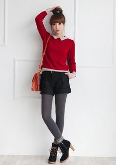Red sweater over button up with black tights: