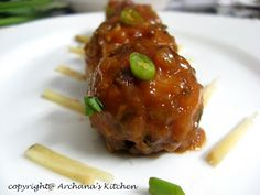 Vegetable Manchurian - A very popular Indian Chinese dish is made from finely minced vegetables, coated with corn flour and deep fried, then dipped in a tangy and spicy soy sauce.