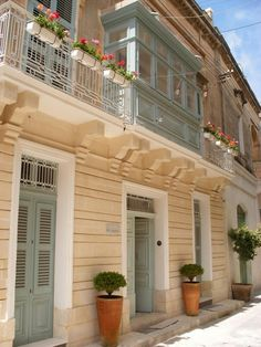 Fully restored to its own glory, this Palazzo in Rabat, Malta boasts 10,700 square feet and features a well-designed kitchen by Antonio Citterio, five en-suite bedrooms, library and wine cellar. Soft blue doors and shutters are paired with sand-colored stone for a soothing, inviting Mediterranean exterior.