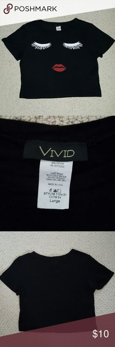 Vivid Eyelashes/Lips Black Crop Top 95% Rayon / 5% Spandex  This is a extremely soft and lightweight fabric that measures 16.5 from shoulder to hemline. It is very stretchy and can be worn as form fitting or loose depending on your style. It is in great condition without any rips, stains or tears.  *Ships out next day / Bundle to Save 15%* Vivid Tops Crop Tops