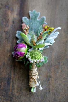 Boutonniere with succulent, dusty miller, and buds (but pink instead of purple