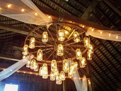 love this wagon wheel chandelier with mason jars alternating length wagon wheel mason jar