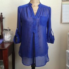 Sheer Blouse Beautiful blue, sheer blouse with 3/4 sleeves. In good, pre-owned condition! Iz Byer Tops Blouses