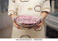 Salad Herring under a fur coat in a glass dish. - stock photo