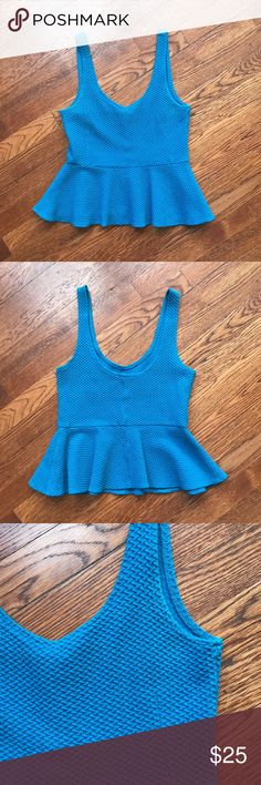 Textured Peplum Tank Beautiful thick fabric with a lot of stretch. In perfect condition, the slightest discoloration on the arm as pictured.  🙅🙅 No Trading  💁 Reasonable Offers are Always Welcomed Anthropologie Tops Tank Tops