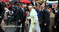 Pope ignores Rome's rain, greeting crowds in an open popemobile
