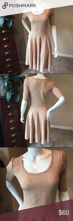 LuLaroe XS Nicole tan textured floral LuLaroe XS Nicole tan textured floral. This dress is beautiful and neutral, great for layering or stand alone. Item is in perfect condition. The Nicole dress boasts a fitted bodice, flattering scoop neck, mid-length sleeves, and a full circle skirt. It is simultaneously casual and dressy and, in a word, feminine! It is the sort of dress that brings out all that is girl in you - and we know you will not be able to resist giving it a twirl. Fun and…
